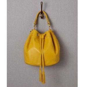 Boden leather tassel bucket mustard drawstring bag